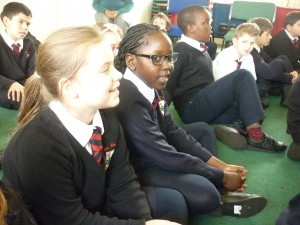 Year 5 warming up for their singing workshop based on their class author, CS Lewis.